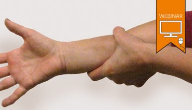 Photograph of a woman holding out her arm.